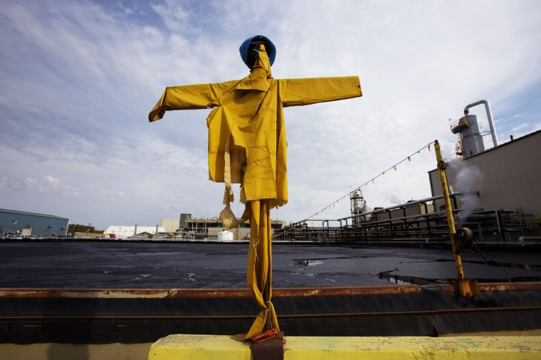 Scarecrow dressed up on sticks to keep birds away from landing on oil ponds at the McKay River Suncor oil sands in-situ operations near Fort McMurray, Alberta. In 1967 Suncor helped pioneer the commercial development of Canada's oil sands, one of the largest petroleum resource basins in the world. Picture taken September 17, 2014. (REUTERS/Todd Korol)