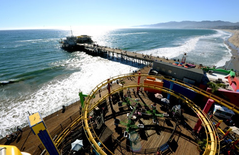 The pier and a small roller coaster can be see from the tip of the ferris wheel at the Santa Monica Pier.