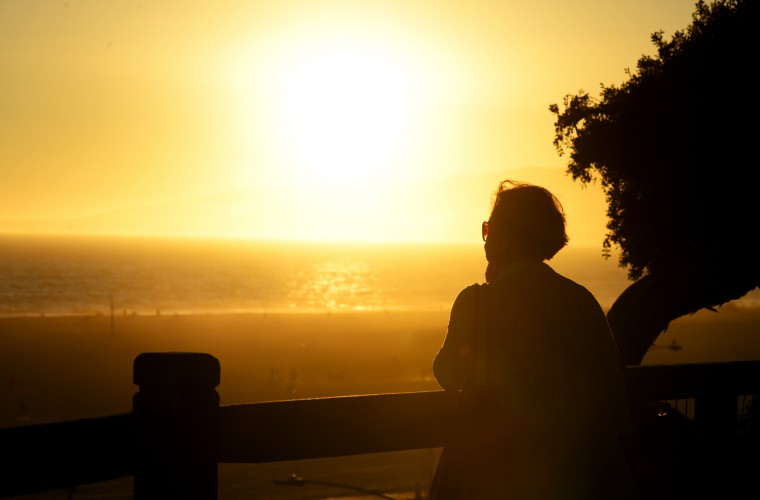 A woman watches the sun set over the beach at Santa Monica. (Yes, I took a lot of sunset shots.)