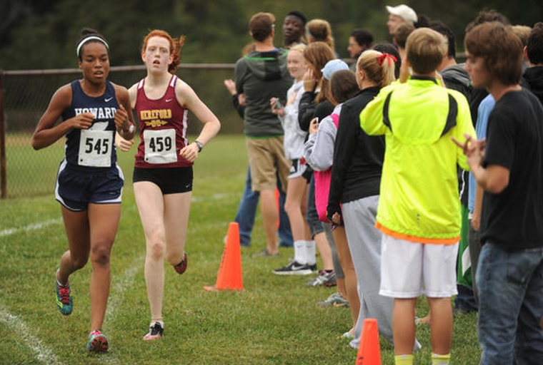 The top two girls finishers, Howard's Gabby Raynor (first) and Hereford'd Sarah Coffey (second), run together for a portion of the Cross Country Barnhart Invitational. (Brian Krista, Baltimore Sun Media Group)