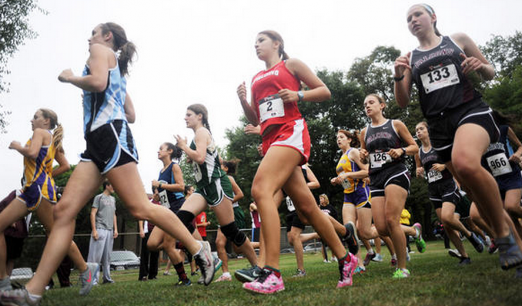Runners compete in the girls varsity race. (Brian Krista, Baltimore Sun Media Group)