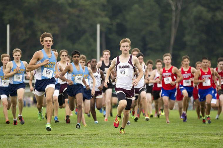 River Hill's Mark Moody, left, and Hammond's Jonathan Gorel, center, take off at the start of the boys varsity race. (Jen Rynda/BSMG)