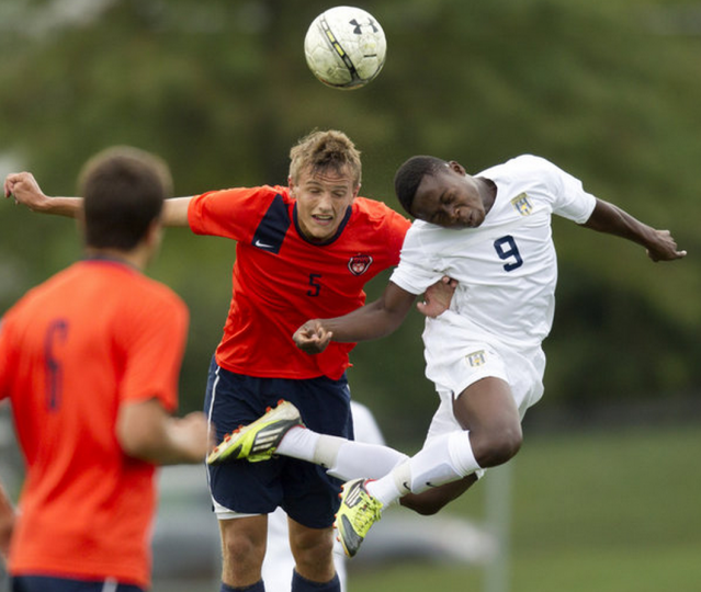 Reservoir's Kyle Saunderson, left, and River Hill's Mike Faderin go up for a header. (Jen Rynda/BSMG)