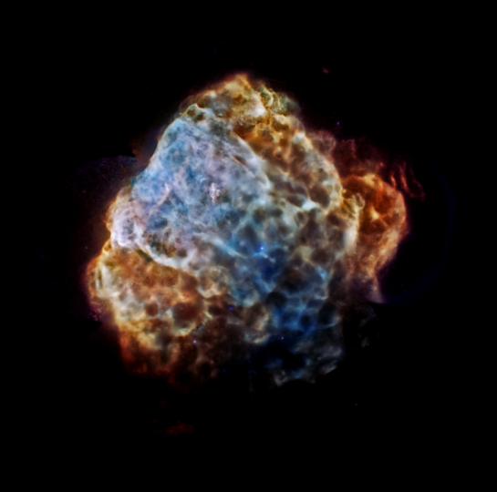 The destructive results of a powerful supernova explosion reveal themselves in a delicate tapestry of X-ray light, as seen in this image from NASA's Chandra X-Ray Observatory and the European Space Agency's XMM-Newton. The image shows the remains of a supernova that would have been witnessed on Earth about 3,700 years ago. The remnant is called Puppis A, and is around 7,000 light years away and about 10 light years across. This image provides the most complete and detailed X-ray view of Puppis A ever obtained, made by combining a mosaic of different Chandra and XMM-Newton observations. Low-energy X-rays are shown in red, medium-energy X-rays are in green and high energy X-rays are colored blue. (NASA/JPL-Caltech)