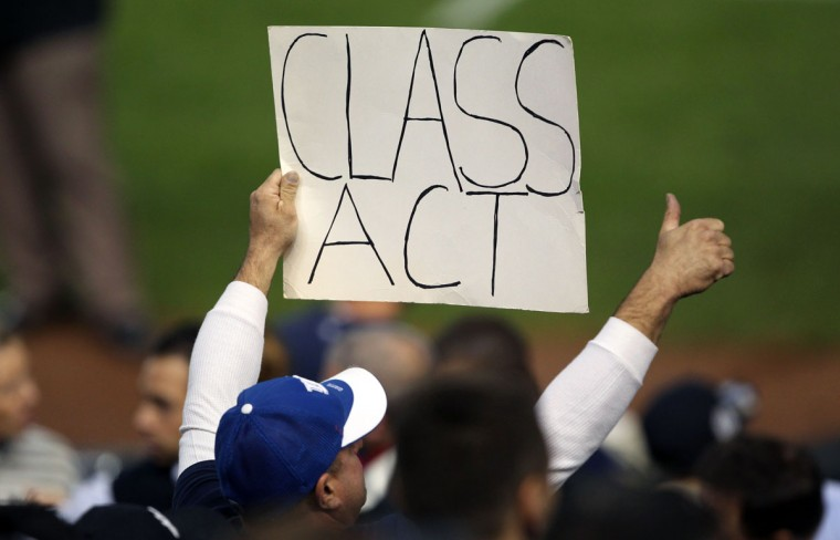 A fan holds a sign for New York Yankees shortstop Derek Jeter (not pictured) during the game against the Baltimore Orioles at Yankee Stadium. (John Munson/NJ Advance Media for NJ.com via USA TODAY Sports)