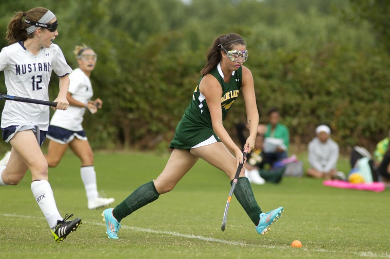 Marriotts Ridge's Keally Ingersoll, left, chases down Wilde Lake's Lizzie Lee, right, during the field hockey game at Marriotts Ridge High School in Marriottsville on Tuesday, Sept. 16, 2014. (Staff photo by Jen Rynda, Baltimore Sun Media Group)