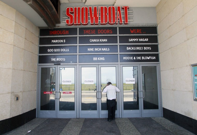 A man tries to peek into the closed Showboat Casino Hotel in Atlantic City, New Jersey September 1, 2014. (Tom Mihalek/Reuters)