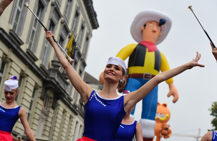 An inflatable of Belgian comics series character Lucky Luke is paraded behind majorettes performing during the Balloon's Day Parade as part of the annual Comic Book Festival in Brussels. (Emmanuel Dunand/AFP-Getty Images)