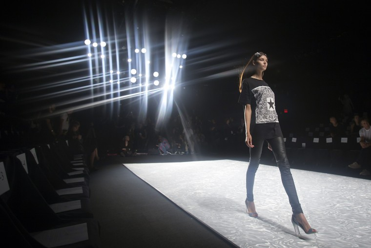 A model does a practice run before the Monique Lhuillier Spring/Summer 2015 runway show during New York Fashion Week in the Manhattan borough of New York. (Carlo Allegri /Reuters)