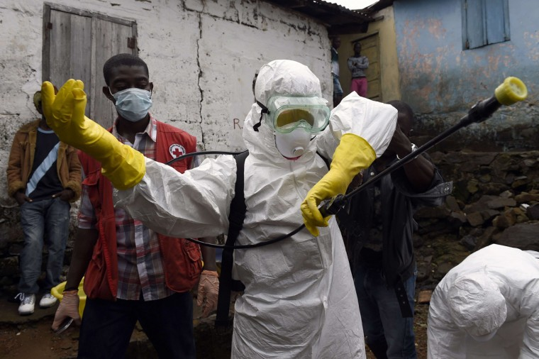 Medical staff members of the Croix Rouge NGO put on protective suits before collecting the corpse of a victim of Ebola, in Monrovia, on September 29, 2014. Of the four west African nations affected by the Ebola outbreak, Liberia has been hit the hardest, with 3,458 people infected -- more than half of the total number of cases. Of those, 1,830 have died, according to a WHO count released on September 27. (Pascal Guyot/AFP/Getty Images)