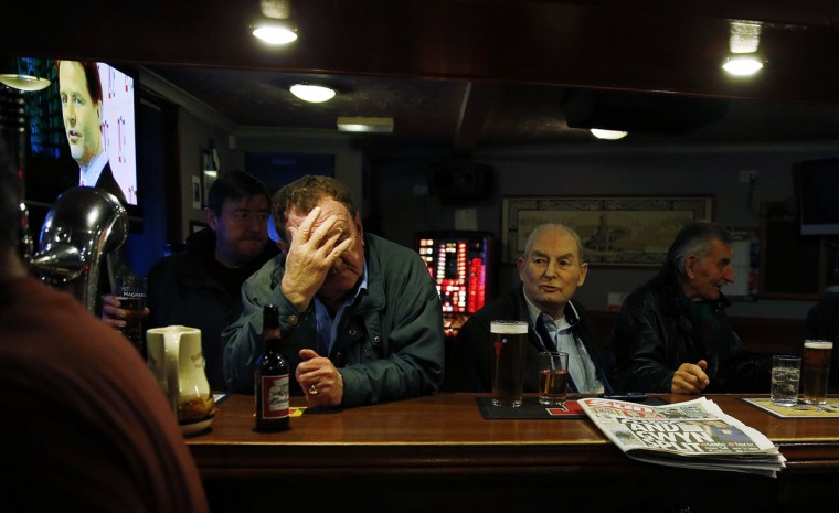 Britain's Deputy Prime Minister Nick Clegg is seen on a television screen as patrons socialise in the Kay Park Tavern, a pub near the main business district in Kilmarnock, Scotland on March 26, 2014. (REUTERS/Suzanne Plunkett)