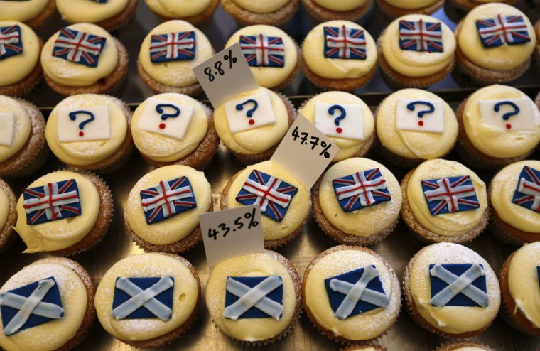 Cup cakes are displayed in the window of Cuckoo's bakery in Edinburgh, in Scotland on September 17, 2014. (REUTERS/Russell Cheyne)
