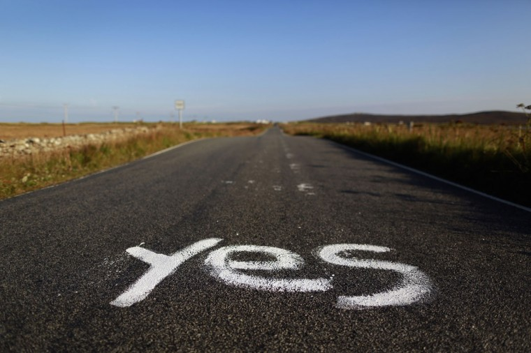 "Graffiti supporting the ""Yes"" campaign is painted on a road in North Uist in the Outer Hebrides on September 17, 2014. (REUTERS/Cathal McNaughton)"