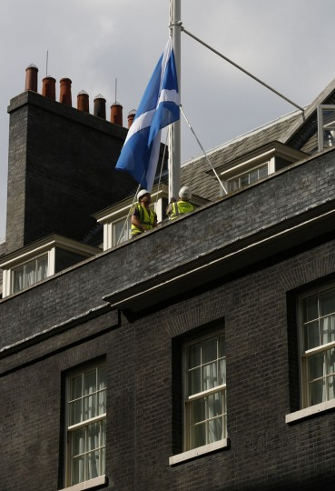 A Scottish Saltire flag is raised over 10 Downing Street in London on September 9, 2014. (REUTERS/Luke MacGregor)