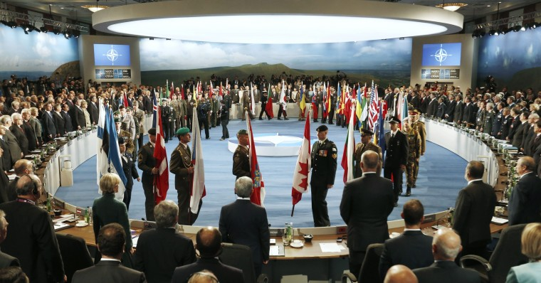 Leaders watch their flags as they participate in a NATO Summit Session One: Meeting on Afghanistan and ISAF at the Celtic Manor Resort in Newport, Wales September 4, 2014. (Larry Downing/Reuters)