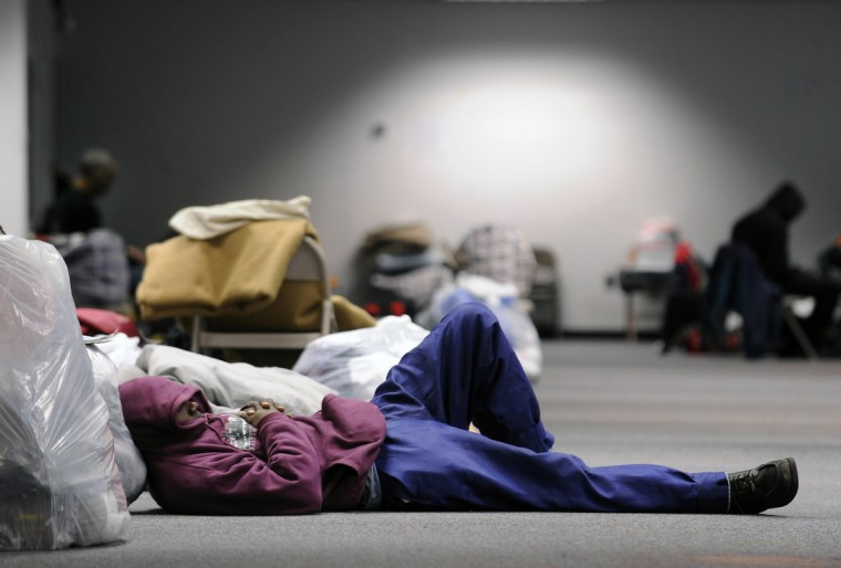 Clients take refuge in the only 24-hour year-round homeless shelter in February 2010 during a heavy snow storm. (Kenneth K. Lam/Baltimore Sun)