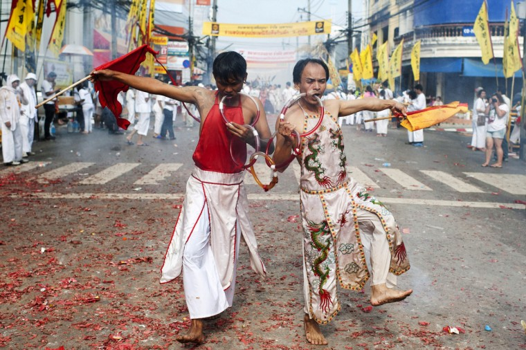 Vegetarian festival devotees of Jui Tui shrine parade through the streets on September 30, 2014 in Phuket, Thailand. (Borja Sanchez-Trillo/Getty Images)