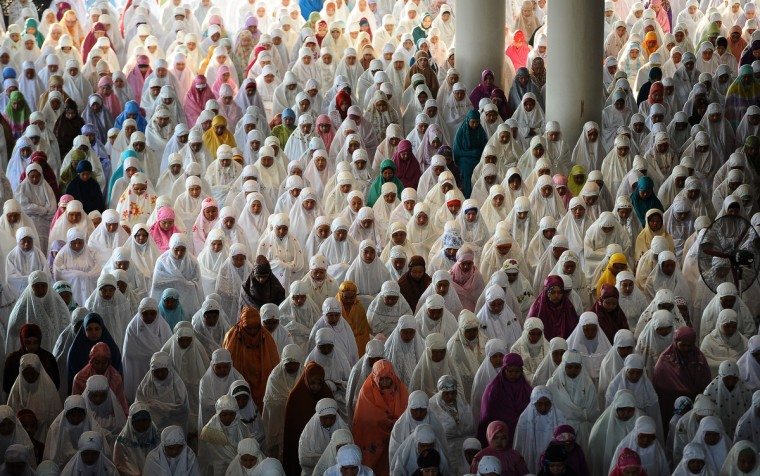 Indonesian Muslims perform Eid Al-Adha prayer at Al-Akbar Mosque on October 5, 2014 in Surabaya, Indonesia. Muslims worldwide celebrate Eid Al-Adha, to commemorate the Prophet Ibrahim's readiness to sacrifice his son as a sign of his obedience to God, during which they sacrifice permissible animals, generally goats, sheep, and cows. (Robertus Pudyanto/Getty Images)