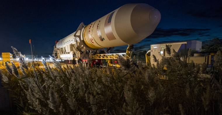 The Orbital Sciences Corporation Antares rocket, with the Cygnus spacecraft onboard, arrives at launch Pad-0A at NASA's Wallops Flight Facility October 24, 2015 in Wallops Island, Virginia. The Antares will launch with the Cygnus spacecraft filled with over 5,000 pounds of supplies for the International Space Station, including science experiments, experiment hardware, spare parts and crew provisions. The Orbital-3 mission is Orbital Sciences' third contracted cargo delivery flight to the space station for NASA. (Joel Kowsky/NASA via Getty Images)