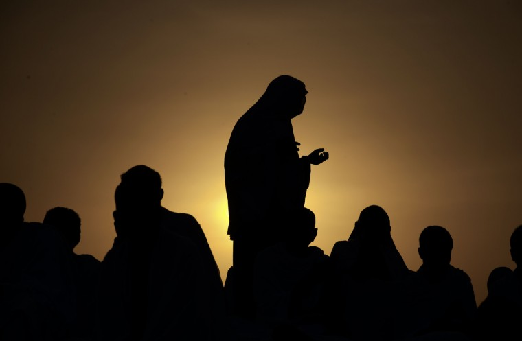 Muslim pilgrims gather on Mount Arafat, near Mecca, to take part in one of the Hajj rituals on October 3, 2014. The pilgrims perform a series of rituals during the annual Hajj. They circumambulate the kaaba seven times, runs back and forth between the hills of Al-Safa and Al-Marwah, drink from the Zamzam Well, goes to the plains of Mount Arafat to stand in vigil, and throws stones in a ritual Stoning of Devil. The pilgrims then shave their heads, perform a ritual of animal sacrifice, and celebrate Eid al-Adha holiday. (Mohammed al-Shaikh/Getty Images)