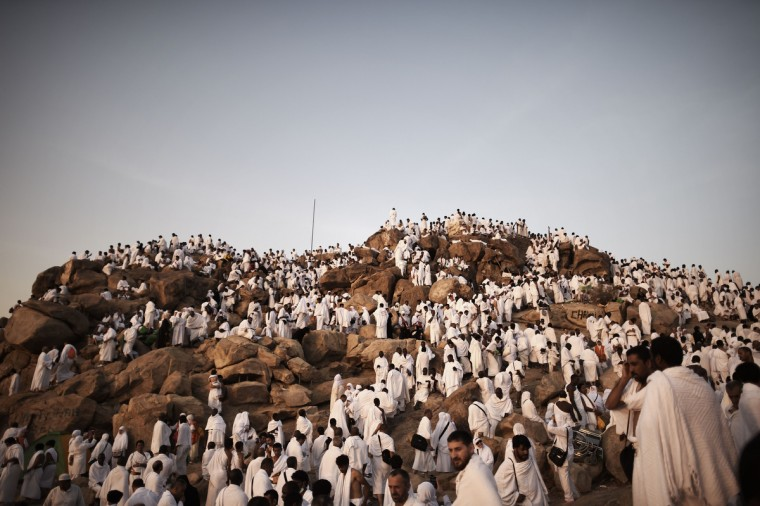 Muslim pilgrims gather on Mount Arafat near Mecca as they perform one of the Hajj rituals late on October 3, 2014. The pilgrims perform a series of rituals during the annual Hajj. They circumambulate the kaaba seven times, runs back and forth between the hills of Al-Safa and Al-Marwah, drink from the Zamzam Well, goes to the plains of Mount Arafat to stand in vigil, and throws stones in a ritual Stoning of Devil. The pilgrims then shave their heads, perform a ritual of animal sacrifice, and celebrate Eid al-Adha holiday. (Mohammed al-Shaikh/Getty Images)