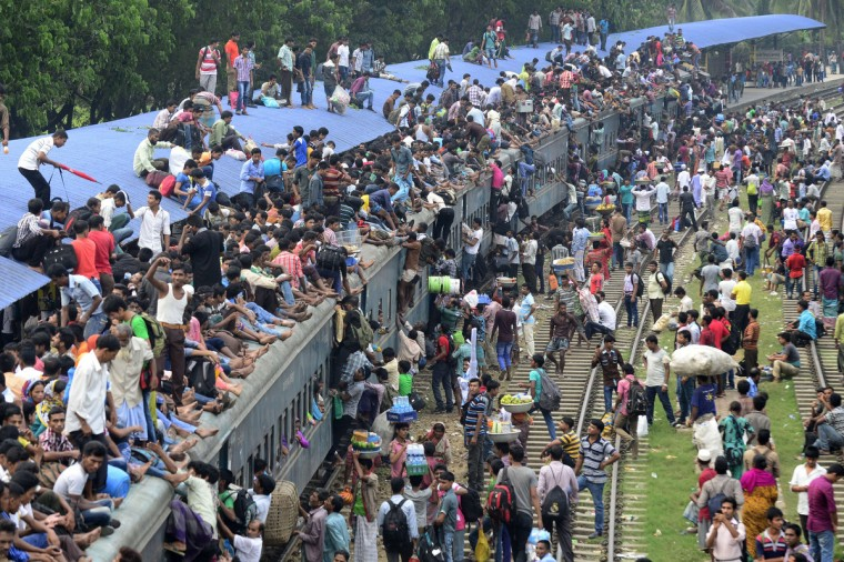Bangladeshi commuters board a train as they rush home to be with their families in remote villages, ahead of the Muslim festival of Eid al-Adha, in Dhaka on October 3, 2014. Muslims across the world are preparing to celebrate the annual festival of Eid al-Adha, or the Festival of Sacrifice, which marks the end of the Hajj pilgrimage to Mecca and in commemoration of Prophet Abraham's readiness to sacrifice his son to show obedience to God. (Munir uz Zaman/Getty Images)