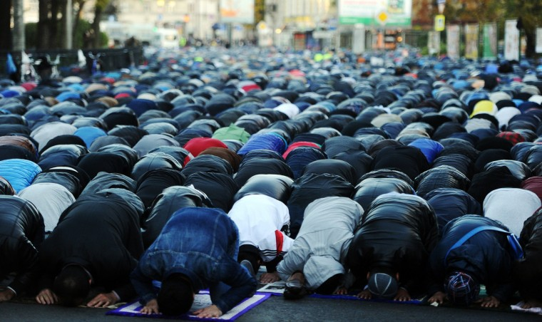Russian Muslims pray outside the Saint Petersburg's main mosque during the first day of the Eid al-Adha (Kurban Bairam) on October 4, 2014. Muslims across the world celebrate the annual festival of Eid al-Adha, or the Festival of Sacrifice, which marks the end of the Hajj pilgrimage to Mecca and commemorates Prophet Abraham's readiness to sacrifice his son to show obedience to God. (Olga Maltseva/Getty Images)