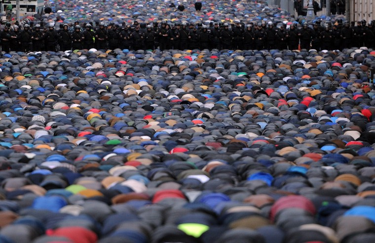 Russian Muslims pray in a street near the Central Mosque during Eid al-Adha festival in Moscow on October 4, 2014. Muslims across the world are preparing to celebrate the annual festival of Eid al-Adha, or the Festival of Sacrifice, which marks the end of the Hajj pilgrimage to Mecca and commemorates Prophet Abraham's readiness to sacrifice his son to show obedience to God. (Vasily Maximov/Getty Images)