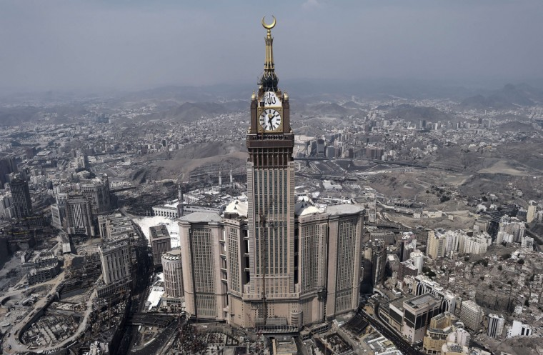 An aerial view shows the clock of the Abraj Al-Bait Towers in the holy city of Mecca, on October 5, 2014. Saudi Arabia said that around 2 millions pilgrims are performing this year's annual Muslim pilgrimage, the hajj. (Mohammed Al-Shaikh/Getty Images)
