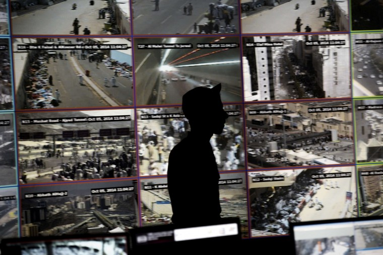 A Saudi officer is seen on duty at the command and control operation center in Mina near the holy city of Mecca, on October 5, 2014. Saudi Arabia said that around 2 millions pilgrims are performing this year's annual Muslim pilgrimage, the hajj. (Mohammed Al-Shaikh/Getty Images)