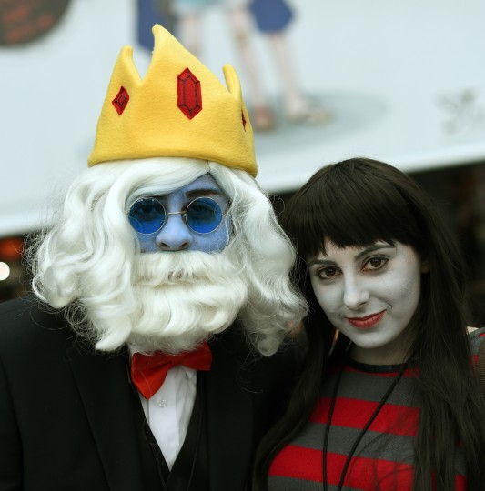 Fans in costume arrive for the opening session of the 2014 New York Comic Con at the Jacob Javits Center. The four day event which runs October 9-12 is the largest pop culture event on the East Coast. Timothy A. Clary/AFP/Getty Images