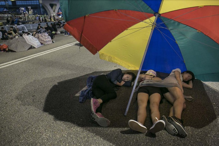 Protesters sleep overnight at the protest site as the standoff continues and authorities threaten to clear the site in the early morning hours of October 6, 2014 in Hong Kong, Hong Kong. Pro-democracy supporters continue to occupy the streets surrounding Hong Kong's Financial district. Protesters have threatened to widen their campaign as they continue to call for open elections and the resignation of Hong Kong's Chief Executive Leung Chun-ying. (Paula Bronstein/Getty Images)