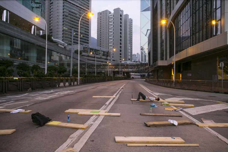 Protesters sleep on a major road adjacent to the protest site as the sun rises October 6, 2014 in Hong Kong, Hong Kong. Pro democracy supporters continue to occupy the streets surrounding Hong Kong's Financial district. Protesters have threatened to widen their campaign as they continue to call for open elections and the resignation of Hong Kong's Chief Executive Leung Chun-ying. (Paula Bronstein/Getty Images)