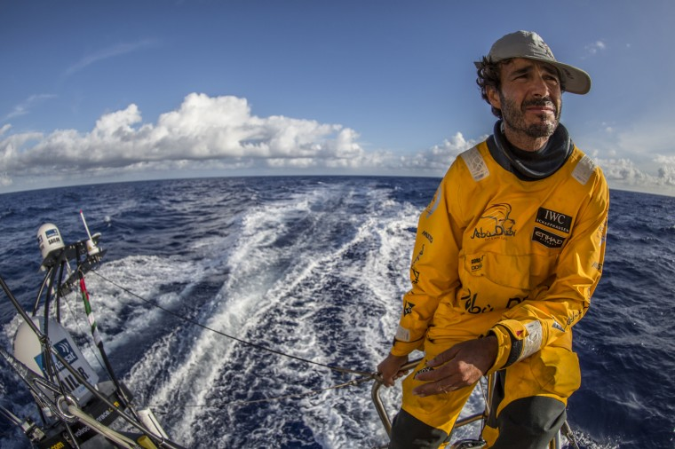 """Onboard Abu Dhabi Ocean Racing. Roberto Bermudez de Castro, aka Chuny, surveys the horizon from the stern of """"Azzam"""" during Leg 1 between Alicante, Spain and Cape Town, South Africa. The Volvo Ocean Race 2014-15 is the 12th running of this ocean marathon. Starting from Alicante in Spain on October 11, 2014, the route, spanning some 39,379 nautical miles, visits 11 ports in 11 countries (Spain, South Africa, United Arab Emirates, China, New Zealand, Brazil, United States, Portugal, France, the Netherlands and Sweden) over nine months. The Volvo Ocean Race is the world's premier ocean race for professional racing crews. (Photo by Matt Knighton/Abu Dhabi Ocean Racing/Volvo Ocean Race via Getty Images)"""