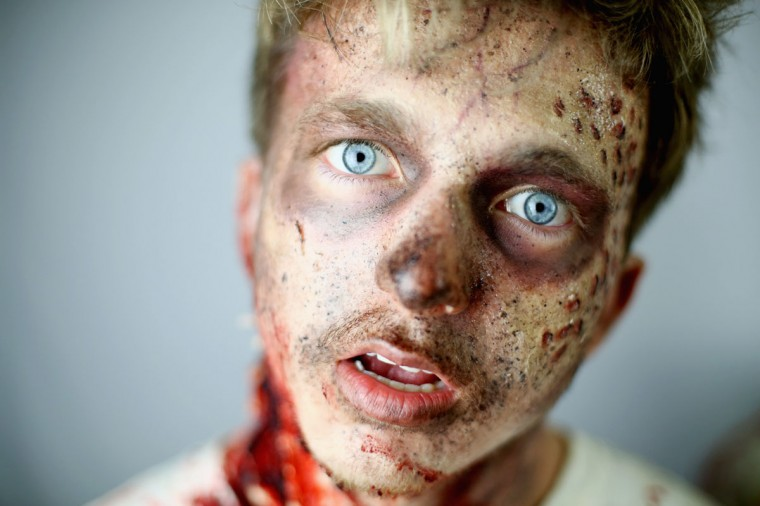 "A model poses during preparations for a Zombie Sydney event at the Australasian College Broadway on October 31, 2014 in Sydney, Australia. To celebrate Halloween, ""zombies"" engage with commuters on their way to work and throughout the day. (Mark Kolbe/Getty Images)"