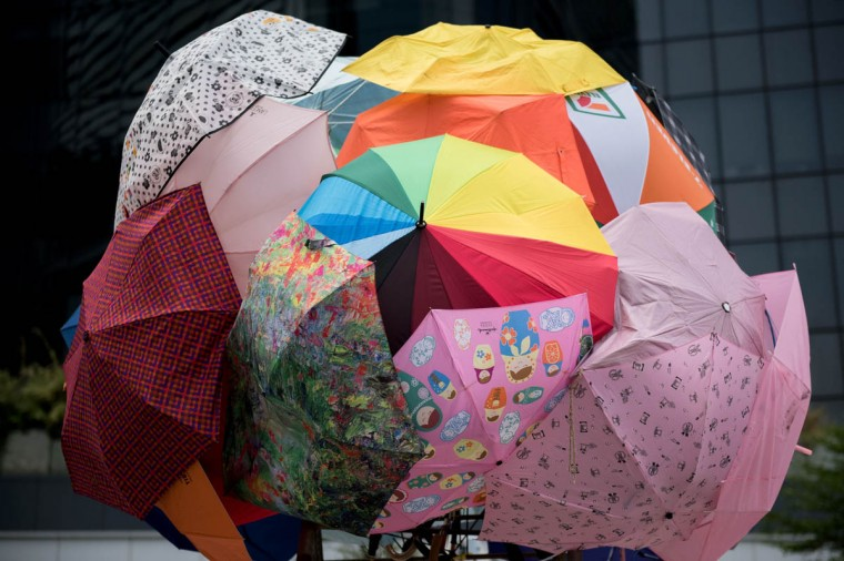 Umbrellas are set up together, symbolizing the so-called 'umbrella revolution' of pro-democracy protests, next to the central government offices in Hong Kong. Hong Kong has been plunged into the worst political crisis since its 1997 handover as pro-democracy activists take over the streets following China's refusal to grant citizens full universal suffrage. (Alex Ogle/Getty Images)