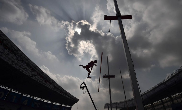 Japan's Akihiko Nakamura competes in the men's decathlon pole vault athletics event during the 17th Asian Games at the Incheon Asiad Main Stadium in Incheon. (Manan Vatsyayana/Getty Images)