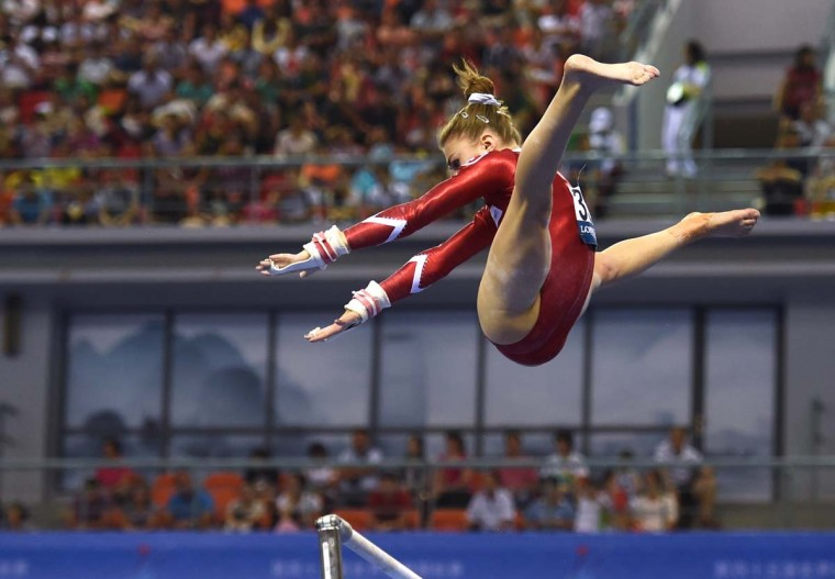 Switzerland's Ilaria Kaeslin performs on the uneven bars during the women's qualification at the Gymnastics World Championships in Nanning, in China's southern Guangxi province on October 5, 2014. (Greg Baker/AFP/Getty Images)