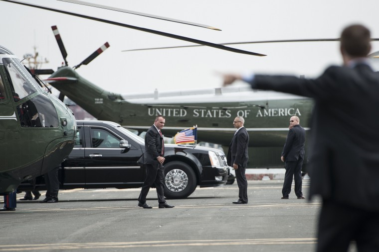 Members of the US Secret Service move a motorcade into position next to Marine One, with US President Barack Obama at the Wall Street Heliport October 7, 2014 in New York. Obama is traveling to New York and Connecticut to fun raise for Democrats. (Brendan Smialowski/AFP/Getty Images)