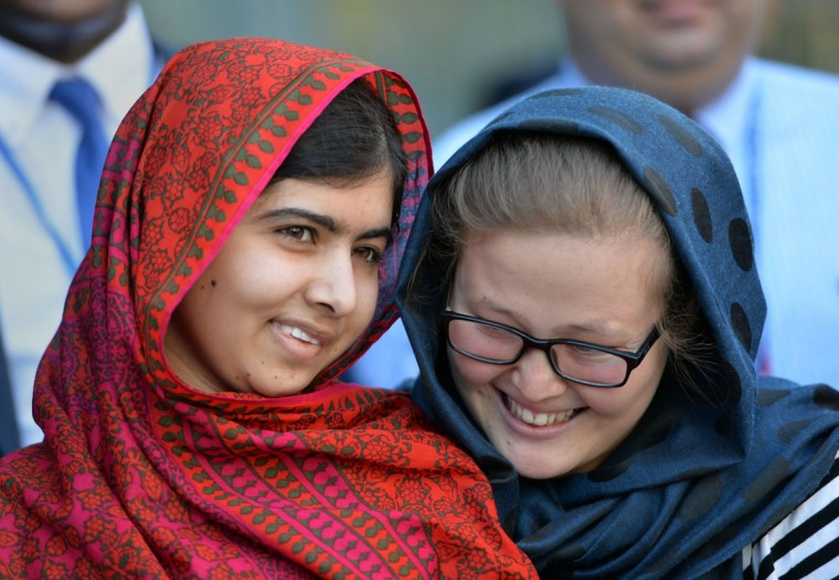 """Pakistani activist Malala Yousafzai (L) meets with students at United Nations headquarters in New York. Pakistan's Prime Minister Nawaz Sharif has congratulated teenage education campaigner Malala Yousafzai on winning the Nobel Peace Prize, calling her the """"pride"""" of his country on October 10, 2014. (Stan Honda/AFP/Getty Images)"""