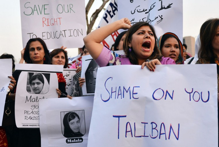 Pakistani civil society activists carry placards with a photograph of the gunshot victim Malala Yousafzai as they shout ant-Taliban slogans during a protest rally against the assassination attempt on Malala Yousafzai, in Islamabad. The Nobel Peace Prize went October 10, 2014 to 17-year-old Pakistani Malala Yousafzai and India's Kailash Satyarthi for their work promoting children's rights. (Aamir Qureshi/AFP/Getty Images)