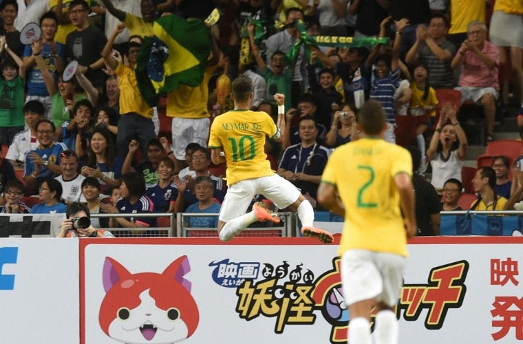 Brazil's Neymar celebrates his first goal in a friendly soccer match against Japan at the National stadium in Singapore on October 14, 2014. (ROSLAN RAHMAN/AFP/Getty Images)