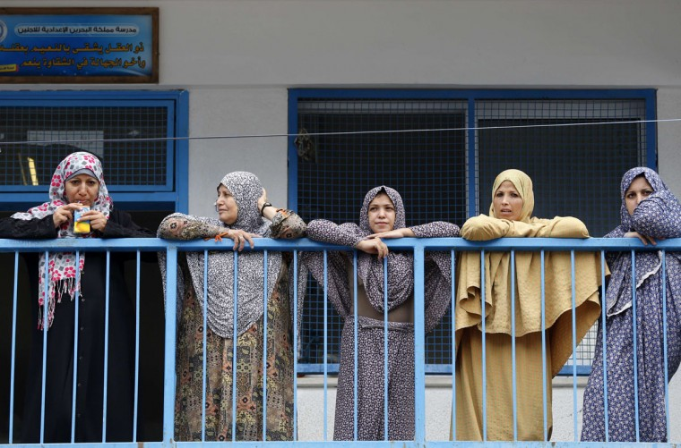 Palestinian women displaced from their homes in Shejaiya neighborhood and are still living in Al-Bahreen UN school, look on during United Nations (UN) Secretary General Ban Ki-moon's (unseen) visit to the school in Gaza City on October 14, 2014. (MOHAMMED ABED/AFP/Getty Images)