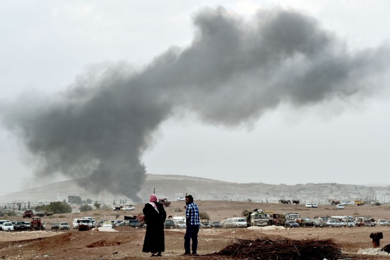 Smoke rises from the the Syrian town of Ain al-Arab, known as Kobane by the Kurds, after a strike from the US-led coalition as it seen from the Turkish-Syrian border in the southeastern village of Mursitpinar, Sanliurfa province, on October 14, 2014. (ARIS MESSINIS/AFP/Getty Images)