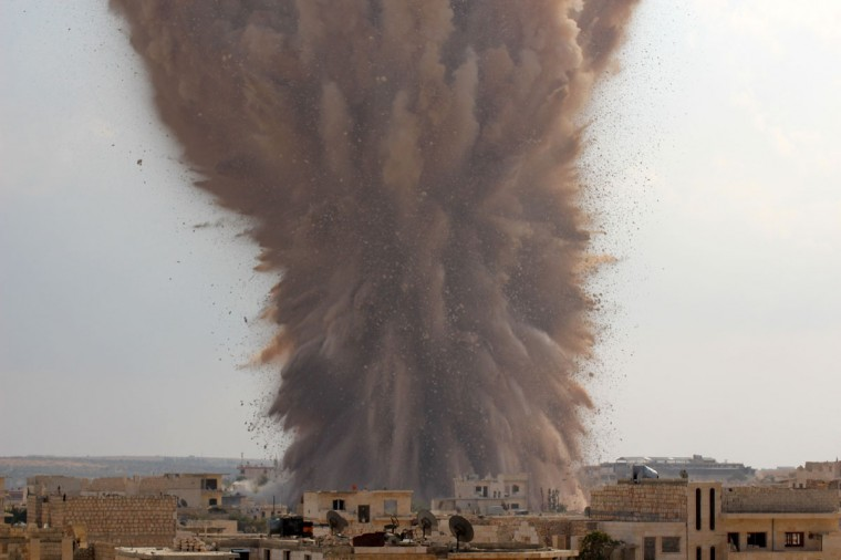 A picture taken on October 14, 2014 shows a large explosion allegedly hitting a Syrian army military outpost in the southern part of the city of Maarat al-Numan in the Idlib province. The explosion was reportedly caused by rebel fighters belonging to Ahrar al-Sham brigade of the Islamic Front coalition that dugged a tunnel underneath the outpost and loaded it with explosives. (GHAITH OMRAN/AFP/Getty Images)