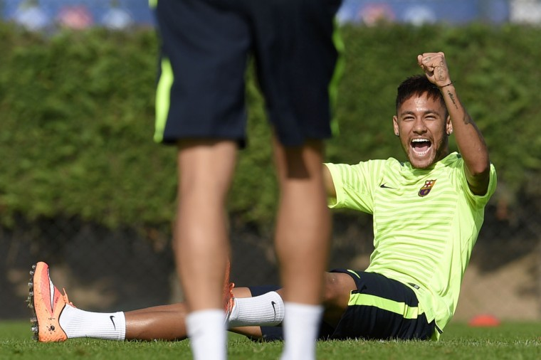 Barcelona forward Neymar da Silva Santos Junior takes part in training session at the Sports Center FC Barcelona Joan Gamper in Sant Joan Despi, near Barcelona on October 20, 2014 on the eve of their UEFA Champions league football match FC Barcelona vs Ajax. (LLUIS GENE/AFP/Getty Images)