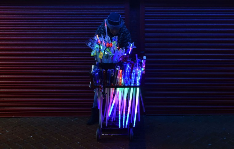 A street seller peddles novelty goods along the Blackpool Illuminations in Blackpool, north west England on October, 19, 2014. (PAUL ELLIS/AFP/Getty Images)
