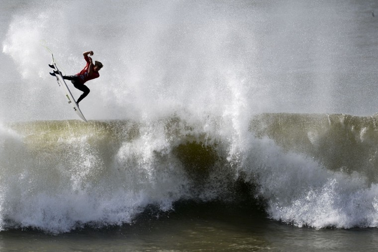 Hawaiian surfer John John Florence competes during his quarterfinal heat of the Moche Rip Curl Pro Portugal at Supertubos Beach in Peniche on October 20, 2014. (PATRICIA DE MELO MOREIRA/AFP/Getty Images)