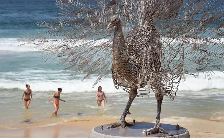 """A sculpture by artist Byeong-Doo Moon of South Korea titled """"Our memory in your place"""" overlooks Sydney's Tamarama Beach as artists from 16 countries prepare their works for the upcoming Sculpture by the Sea exhibition, on October 23, 2014. (William West/AFP/Getty Images)"""