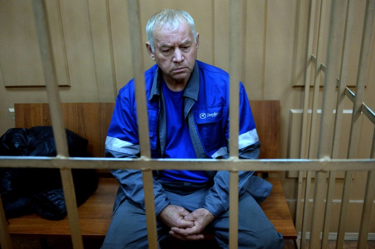 Vladimir Martynenko, the driver of a snowplough involved in the crash that killed the head of French oil giant Total, sits inside the defendant's cage during his hearing in the Basmanny district court in Moscow on October 23, 2014. (VASILY MAXIMOV/AFP/Getty Images)